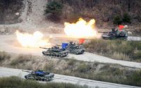 South Korean Army K1A1 and U.S. Army M1A2 tanks fire live rounds during a U.S.-South Korea joint live-fire military exercise, at a training field, near the demilitarized zone, separating the two Koreas in Pocheon, South Korea April 21, 2017. Picture taken on April 21, 2017. REUTERS/Kim Hong-Ji