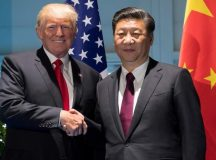 FILE PHOTO - U.S. President Donald Trump and Chinese President Xi Jinping (R) shake hands prior to a meeting on the sidelines of the G20 Summit in Hamburg, Germany, July 8, 2017.  REUTERS/Saul Loeb/Pool/File Photo