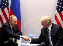 "HAMBURG, GERMANY - JULY 7: (----EDITORIAL USE ONLY  MANDATORY CREDIT - "" RUSSIAN PRESIDENTIAL PRESS AND INFORMATION OFFICE / HANDOUT"" - NO MARKETING NO ADVERTISING CAMPAIGNS - DISTRIBUTED AS A SERVICE TO CLIENTS----)  Russia's President Vladimir Putin (L) and US President Donald Trump (R) shake hands during a bilateral meeting on the sidelines of the  G20 summit in Hamburg, Germany, on July 7, 2017.  (Photo by Russian Presidential Press and Information Office/Anadolu Agency/Getty Images)"