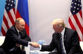 """HAMBURG, GERMANY - JULY 7: (----EDITORIAL USE ONLY  MANDATORY CREDIT - """" RUSSIAN PRESIDENTIAL PRESS AND INFORMATION OFFICE / HANDOUT"""" - NO MARKETING NO ADVERTISING CAMPAIGNS - DISTRIBUTED AS A SERVICE TO CLIENTS----)  Russia's President Vladimir Putin (L) and US President Donald Trump (R) shake hands during a bilateral meeting on the sidelines of the  G20 summit in Hamburg, Germany, on July 7, 2017.  (Photo by Russian Presidential Press and Information Office/Anadolu Agency/Getty Images)"""
